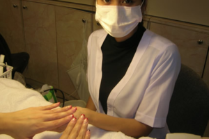 Manicurist Wearing Mask