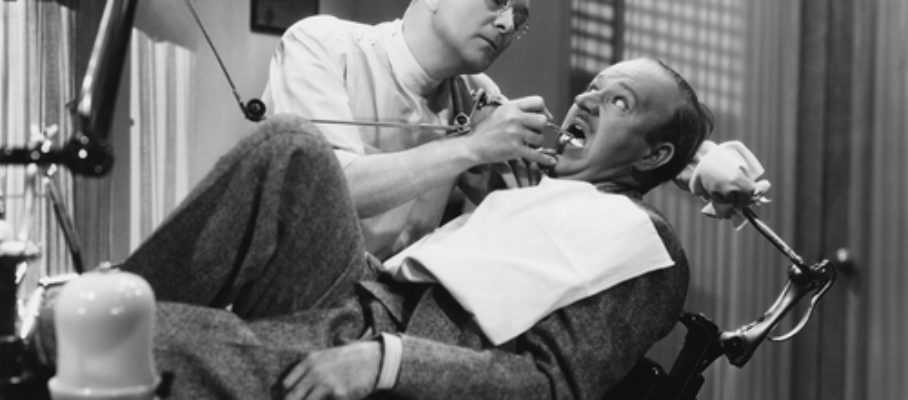 Dentist leaning over patient