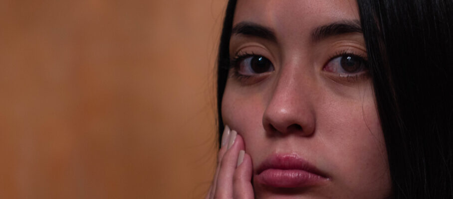 A,Close-up,Portrait,Of,A,Young,,Hispanic,,Sad,Woman,With